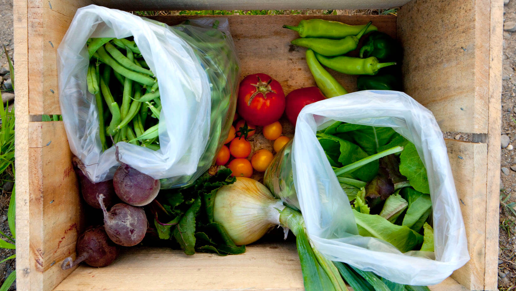 Fresh produce in a wooden box